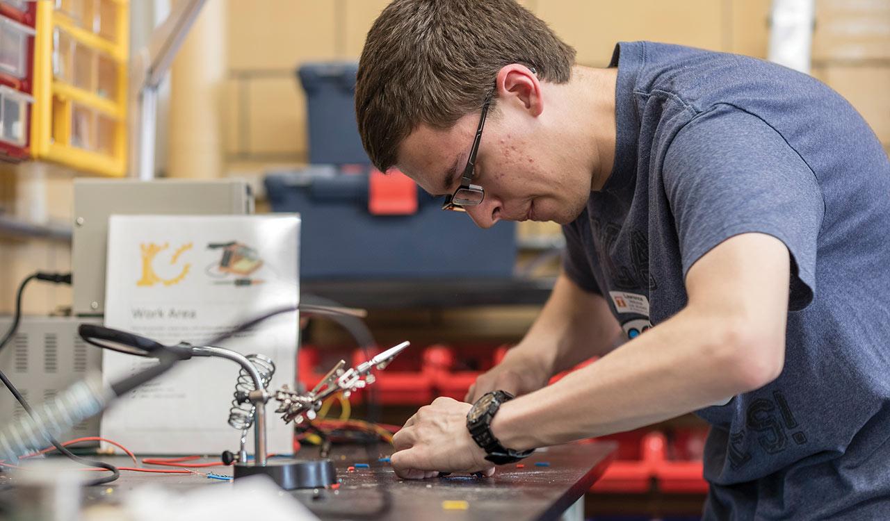 Student using soldering station